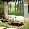 Outdoor mural on wall of Sewage Treatment Plant, painted by Cherry.